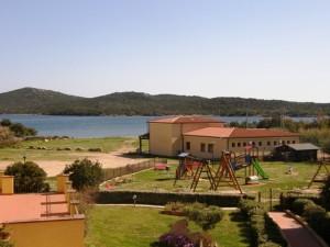 Porto Pozzo,ampio appartamento fronte mare splendido!!!!